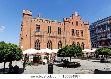 KOLOBRZEG POLAND - JUNE 23 2016: Side view of the neo-Gothic building of Town Hall that was built from 1829 to 1832 and rebuilt in 1913