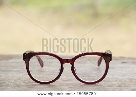 Red glasses on old wood table background