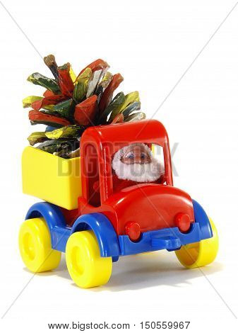 Toys car-truck and Santa Claus with gifts isolated on white background
