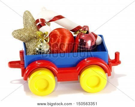 Toys truck trailer with gifts and toys isolated on white background
