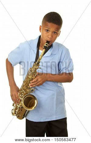 Handsome Eleven Year Old Boy on White Background Playing the Saxophone