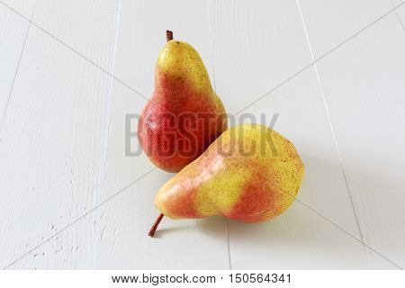 Bartlett pears on a wooden table.