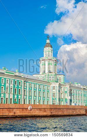 Architecture landscape of St Petersburg Russia - Kunstkamera building at the University quay near the Neva river in St Petersburg Russia. View of St Petersburg landmark in sunny weather