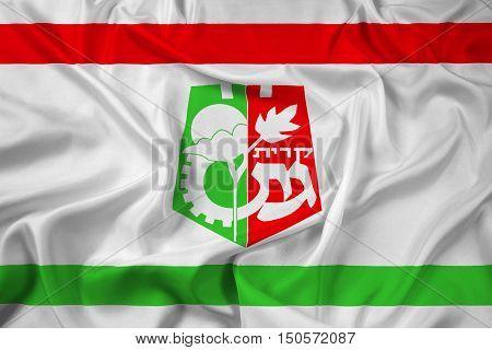 Waving Flag of Kiryat Gat Israel, with beautiful satin background. 3D illustration