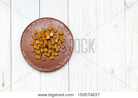 cheesecake cheese chocolate on white boards flat lay