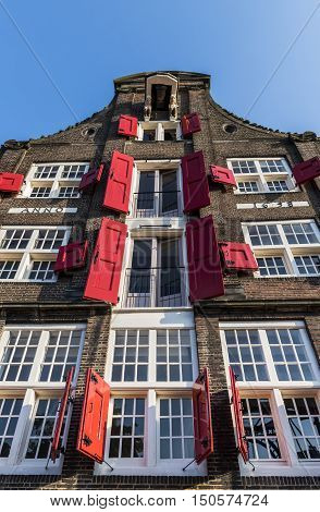 Dordrecht The Netherlands - September 13 2016: Old monumental house with red shutters in Dordrect The Netherlands