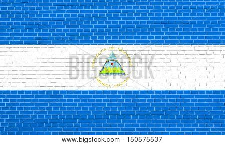 Nicaraguan national official flag. Patriotic symbol banner element background. Accurate dimensions. Correct size colors. Flag of Nicaragua on brick wall texture background, 3d illustration