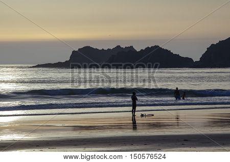 Algarve: Surfer beach Praia da Arrifana near Aljezur on sunset Portugal