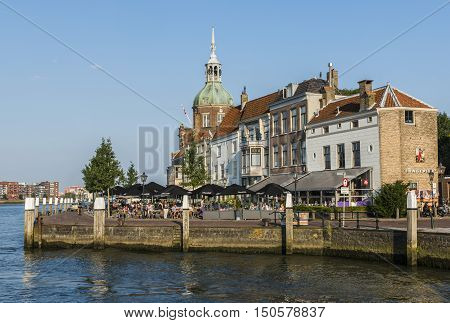 Dordrecht The Netherlands - September 13 2016: Terrace in Dordrecht with Groothoofdspoort and water of the Merwede in Zuid-Holland The Netherlands.