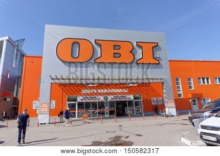 Nizhny Novgorod, Russia. - May 26.2016. Obi Store Sells Tools And Materials With Parked Cars.