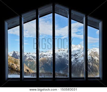 Snowy Peaks Through the Window of an Alpine Cabin.  Temple Basin, Arthurs Pass, Southern Alps, New Zealand.