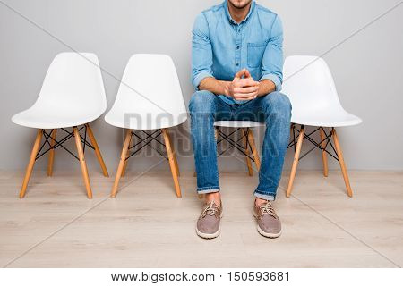 Close Up Of Man In Jeans Waiting For Smth While Sitting On Chair