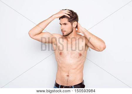 Healthy Muscular Young Guy Combing His Hair