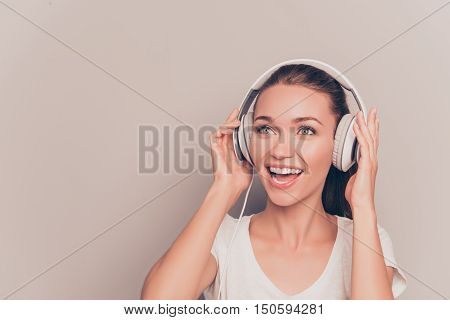 Portrait Of Happy Music Lover Listening Music And Singing