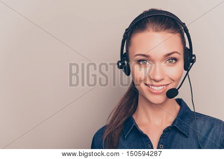 Beautiful Consultant Of Call Center In Headphones On Gray Background
