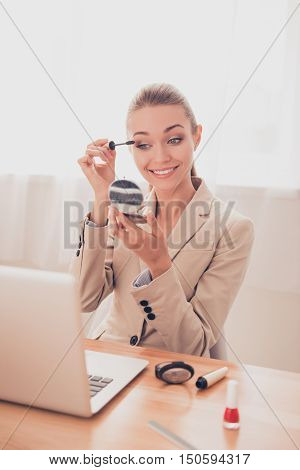 Attractive Woman In Office Having Break And Doing Maquillage
