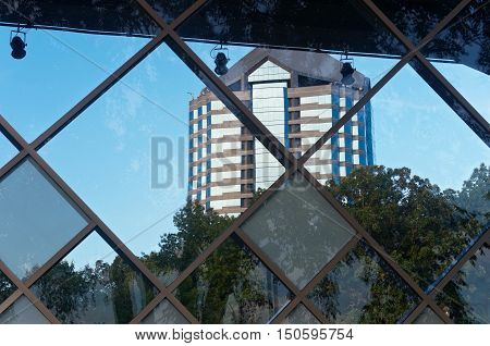 corporate office high rise framed by glass wall and trees in bloomington minnesota