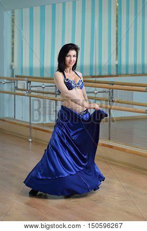 Beautiful woman in arabic costume posing, oriental or belly dance.