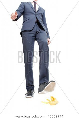 A business man about to step in banana peel poster