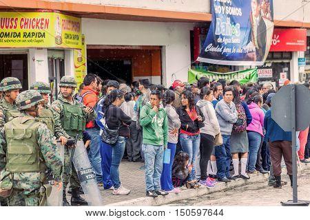Banos De Agua Santa Ecuador - 23 June 2016: Group Of Supporters With Ground Force Of Ecuador Army Waiting For The President Rafael Correa Delgado In Banos De Agua Santa Ecuador South America