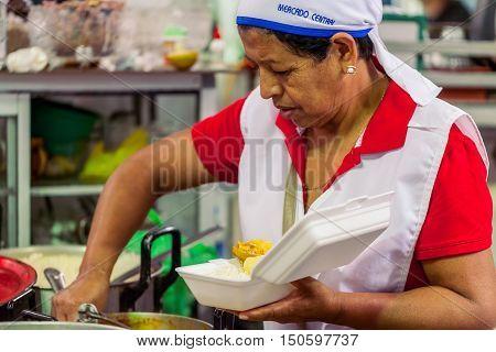 Banos De Agua Santa Ecuador - 23 2016: Unidentified Chef Woman From Banos De Agua Santa Is Preparing A Dish In Banos De Agua Santa On 23 2016