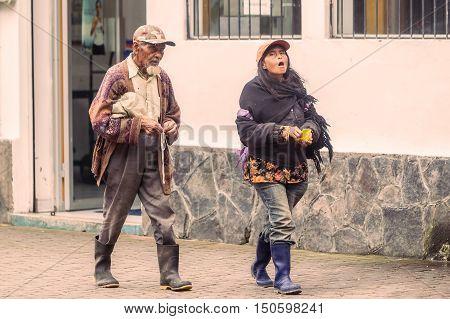 Banos De Agua Santa Ecuador - 23 June 2016: Ecuadorian People Walking On The Streets Of Banos De Agua Santa Ecuador South America