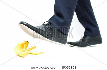 A business man about to step in banana peel