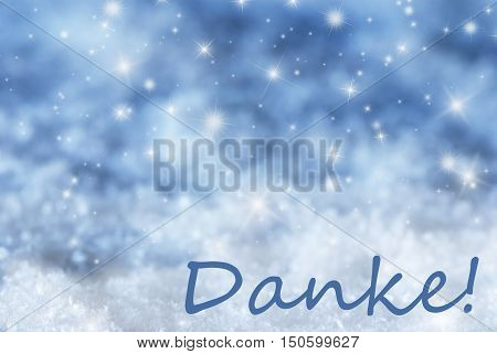 German Text Danke Means Thank You. Blue Sparkling Christmas Background Or Texture With Snow. Copy Space For Your Text Here