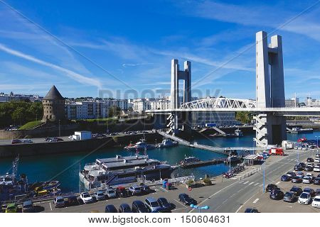 Brest, France, October 3, 2016: The Tanguy tower, the vertical lifting bridge and the Marine Port in the Penfeld river of Brest in France.