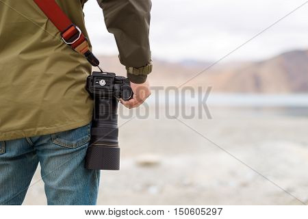 Photographer with Digital camera. travel background. Outdoors photographer concept.