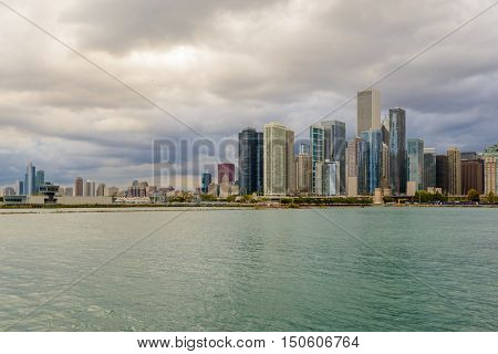 Chicago skyline with skyscrapers viewed over lake.