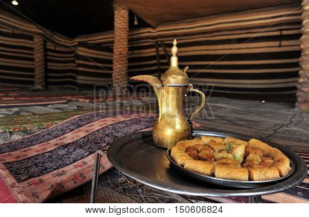 A Bedouin tent with Backlava and coffee for Bedouin hospitality.