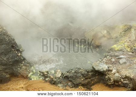 Seething cauldron of boiling water in the crater of Mutnovsky volcano.