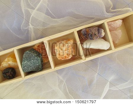 Stones for crystal healing in wooden box