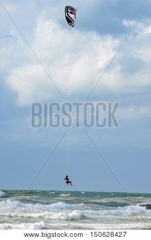 Man is kite boarding in the sea ocean