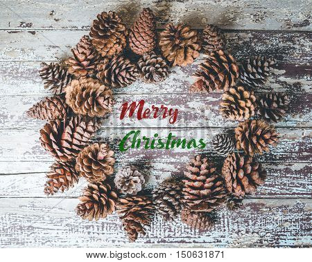 Christmas Decoration With Pine Cones On Rustic Wooden Background