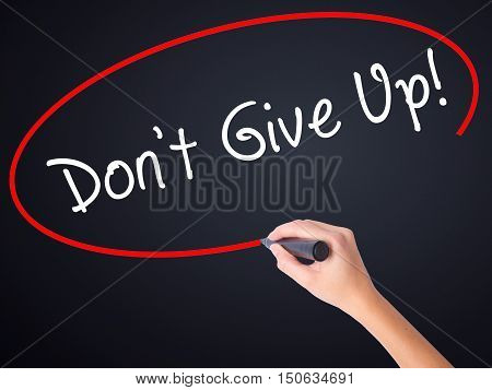 Woman Hand Writing Don't Give Up With A Marker Over Transparent Board