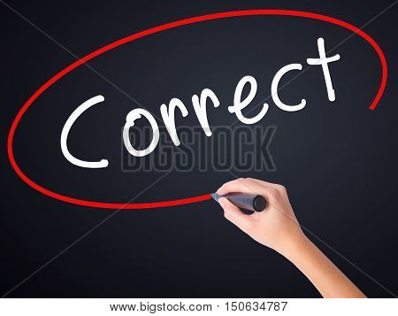 Woman Hand Writing Correct With A Marker Over Transparent Board