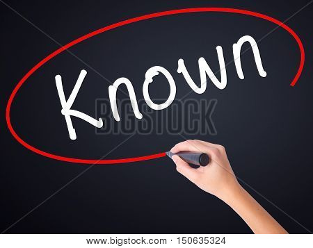Woman Hand Writing Known With Marker On Transparent Wipe Board