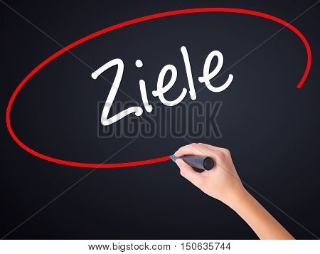 Woman Hand Writing Ziele  (goalsin German) With A Marker Over Transparent Board