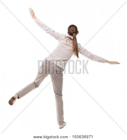 Balancing young woman.  or dodge falling woman. Rear view people collection.  backside view of person.  Isolated over white background. A girl in a gray jacket teetering on foot.