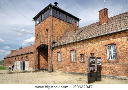 OSWIECIM POLAND - MAY 12 2016: Main gate in concentration camp Auschwitz Birkenau II in Brzezinka Poland.