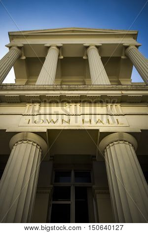 Grand town hall with gold carved lettering and columns