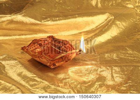 Golden Diwali - Handmade Diya in gold color background