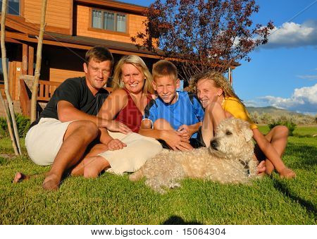 Family in front of home