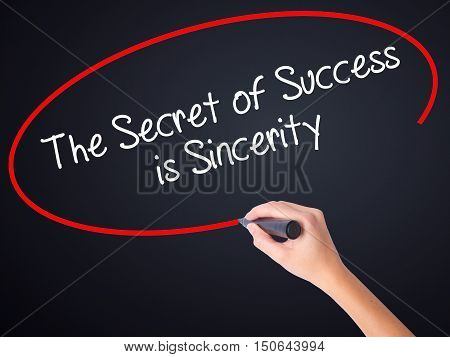 Woman Hand Writing The Secret Of Success Is Sincerity With A Marker Over Transparent Board .