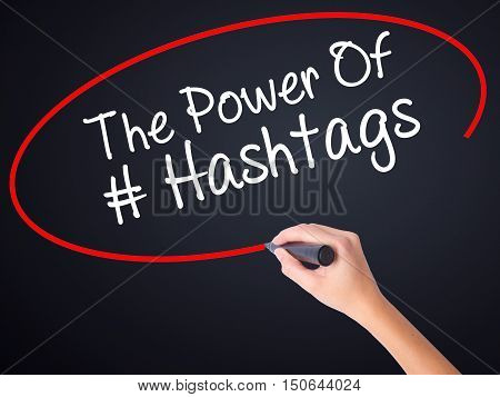 Woman Hand Writing The Power Of Hashtags With A Marker Over Transparent Board