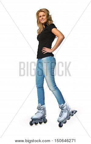 Girl wearing inline skates isolated on a white background.