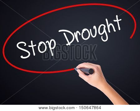 Woman Hand Writing  Stop Drought With A Marker Over Transparent Board
