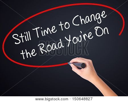 Woman Hand Writing Still Time To Change The Road You're On With A Marker Over Transparent Board